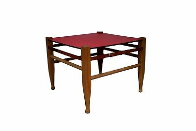 Square Danish safari table with table top in red formica, leather straps