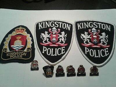 lot of older city of kingston police patches and pins  9 items
