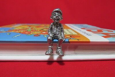 Pewter Young Boy Seated  Figurine
