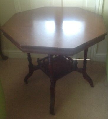 A Lovely Antique Victorian Mahogany Octagonal Table With Ceramic Casters