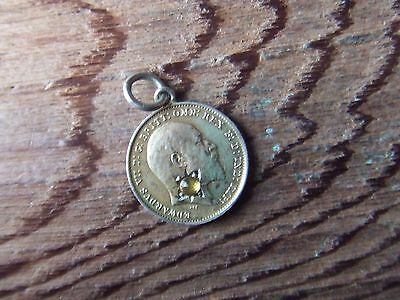 Edwardian. 1910, Gold Plated Silver Threepence Set With A Facceted Yellow Stone.