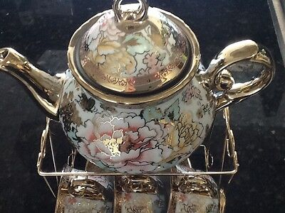 13pc Chinese Tea Sets - Tea Pot & 6 Cups & Saucers with Rack. (Multi color)..