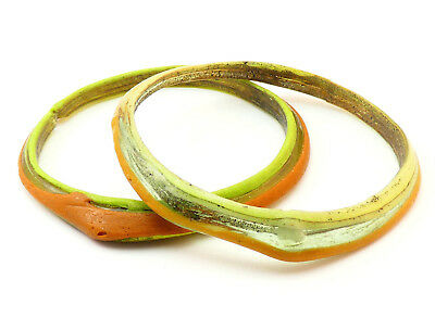 c100-400 AD, ANCIENT PAIR OF STRIATED ORANGE GREEN GLASS ROMAN BRACELET BANGLES
