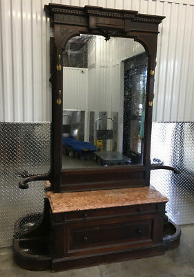 Antique Walnut Mirrored Hall Tree has a Marble Top Base with Drawers