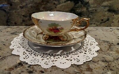 Vintage Tri-Footed Classica China Tea Cup And Saucer Set With 22 Carat Gold Trim