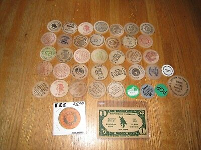 Lot of 35 Wooden Nickels, 1 Wooden Certificate from 1950 & a few plastic tokens