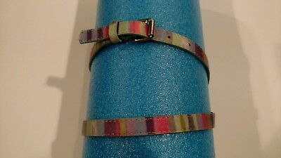Girl's belt with rainbow colors and made of a leather material.