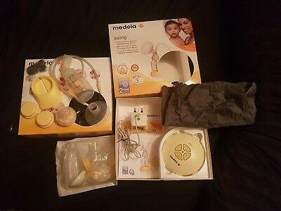 Medela Swing Single Electric Breast Pump - New bottle and accessories included