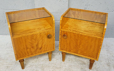 A pair of 20th century satin birch bedside cabinets / cupboards.