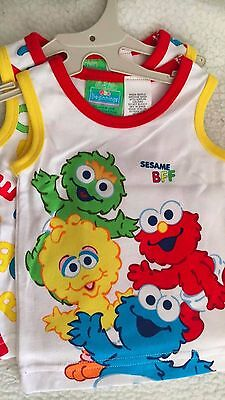 SESAME STREET size  0  BABY PACK OF TWO SINGLETS, NEW ON HANGER, ABC and Crew