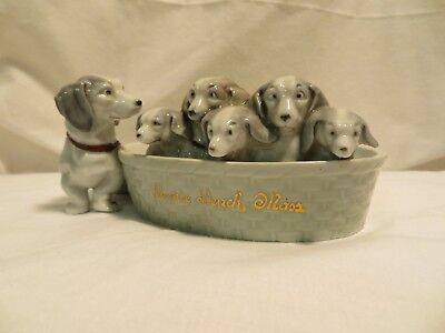 Heubach? dachshunds in a basket with mom