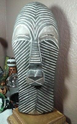 Interesting vintage hand carved wooden possible African wall sculpture,mask
