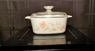 "Corning ""Peach Floral"" A 1 1/2 B 1.5 quart covered casserole with A 7 C lid"