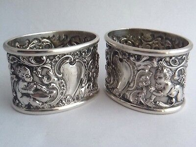 Outstanding Pair Of Heavy Silver Victorian Rococo Napkin Rings With Cherubs 1896