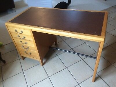 A Vintage Midcentury Oak Desk With Original Handles And Faux Leather Insert.