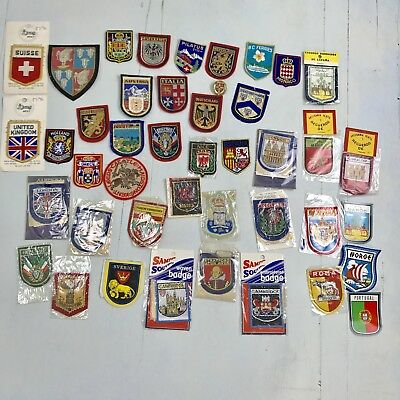 DX- Lot of 40 vintage embroidered European country patches unused with & w/o pac