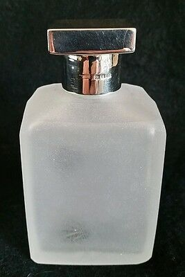 Cut glass scent bottle,with a sterling silver cover. London 1928. By F & Co Ltd