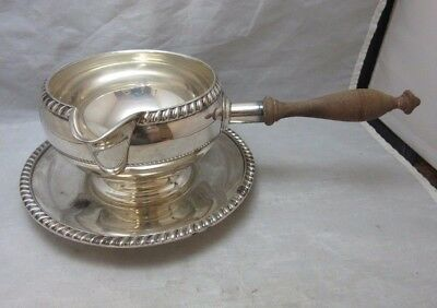 Vintage gravy or sauce pourer with underplate