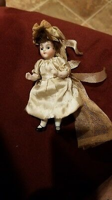 """Antique 4"""" German Bisque Doll w Glass Eyes. Movable limbs. In Wedding Dress."""
