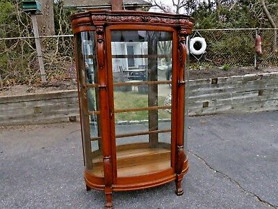 CARVED OAK CURIO CABINET Figural Victorian Era CURVED GLASS Claw Feet LION HEADS