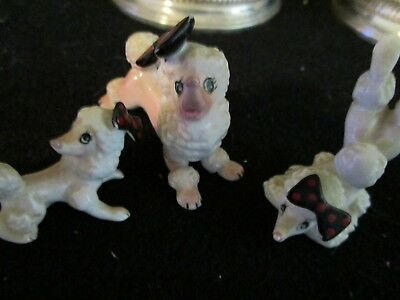vintage minature poodle figurines, with  bows