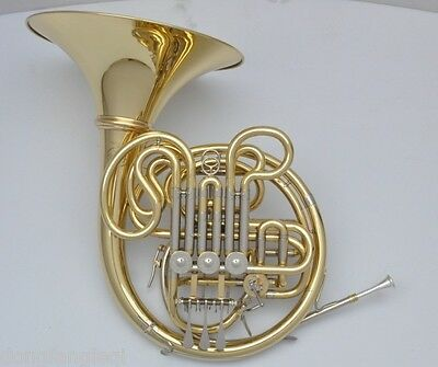 Professional gold lacquer four key double Bb/F French Horn. by Eastern  Music
