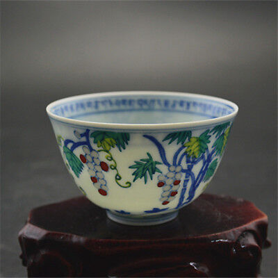 Chinese Old Marked Contrasting Colored Grape Fruits Carved Dragon Porcelain Cup