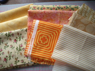 9 pieces 100% cotton quilting / patchwork material shades of yellow  and orange.