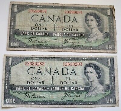 Lot of 2 - 1954 Canada One Dollar Bills With Devils Face - Bank Of Canada $1