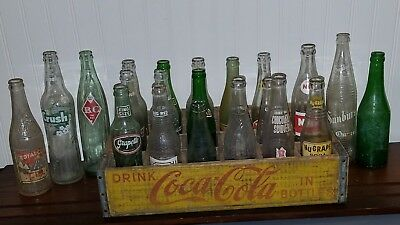 Vintage Wooden Yellow Coca Cola Crate with 21 Variety of vintage Bottle lot
