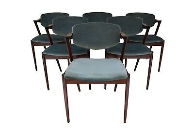 A set of six Danish midcentury rosewood armchairs by Kai Kristiansen, model 42