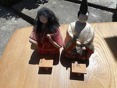 excellent pair of japanese figures in costume on stands with writing on