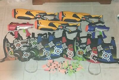 Lot of NERF dart tag blaster gun with 5 blasters, 9 vest, 2 glasses and bullets