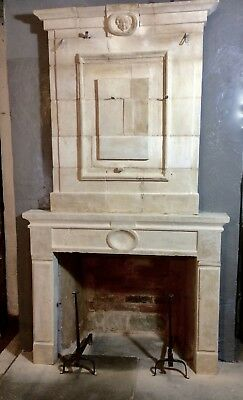 Antique stone fireplace with carved head / fire surround