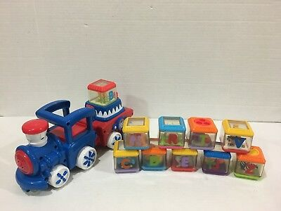 Fisher-Price Peek-A-Blocks Circus Train with Sounds Lights 10 Alphabet Letters