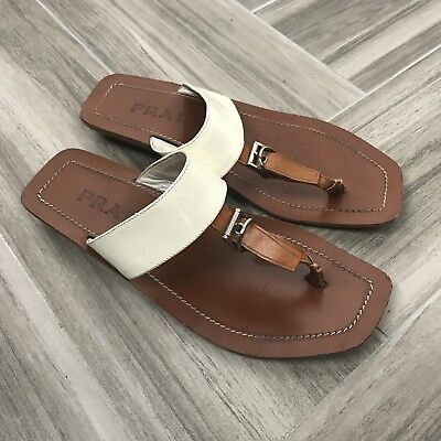 b91e61ed6 Prada Womens Thong Leather Flat Sandals Size 37 Tan and White Top Buckle  Detail
