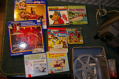 Pathescope 8mm movie projector and 8 movies