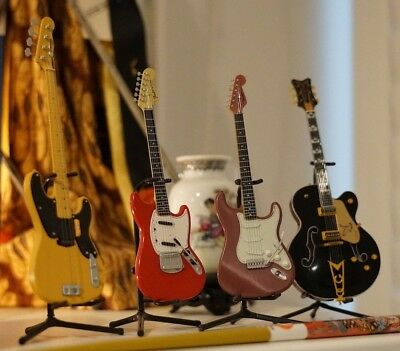 Collectable miniature Fender and Gretsch Guitars Made in Japan - Plastic Fragile