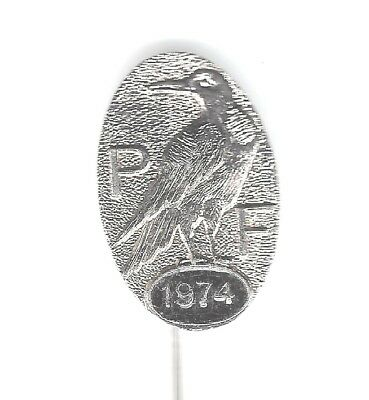 1974 P F oval silvered pin badge - Crow? - BERTRAM maker