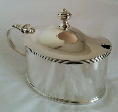 A George V sterling silver mustard pot. London 1921.By Charles & Richard Comyns
