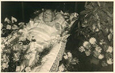 Post Mortem Elderly Lady in a coffin lined in silk and surrounded by flowers