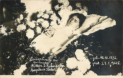 Post Mortem Lady in a coffin surrounded by flowers born 1875 died 1925