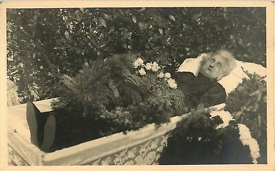 Post Mortem Elderly Lady in a coffin surrounded by flowers