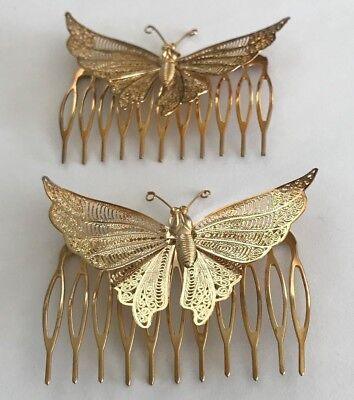 A Pair of Gold Tone Butterfly Hair Combs