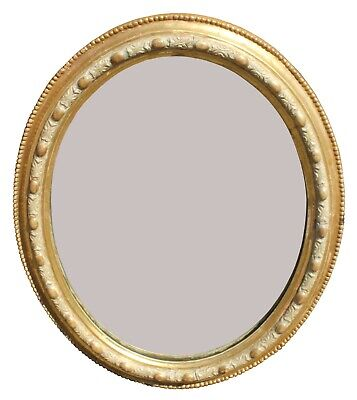 A Small oval Gilt Victorian Mirror