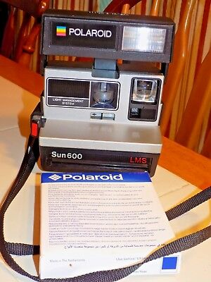 Polaroid Sun 600 LMS Instant Film Camera with Sealed Pack of Film NOS - Untested