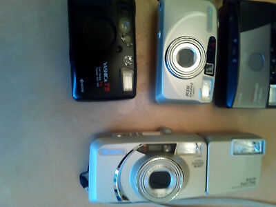 Lot Of Four Used Compact Cameras And One Flash