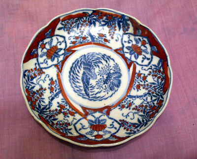 Decorative Japanese blue and white plate with overglaze red enamel. Late 19thC