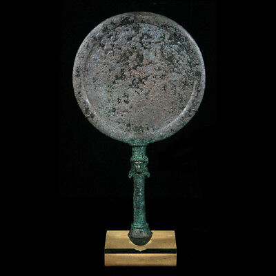 A fine and important Bactrian bronze mirror with figurative handle y3096