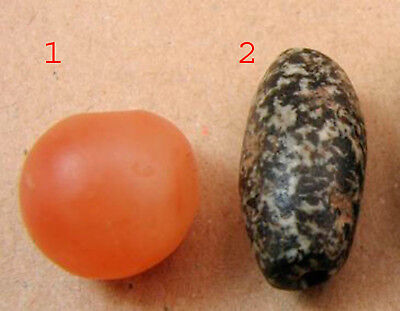 Two neolithic beads one of Diorite the other of Quartz.